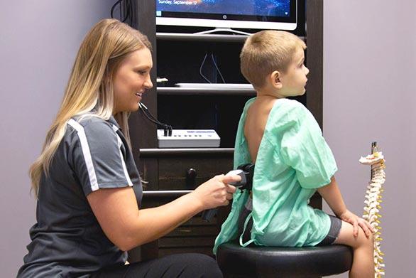 Chiropractic Traverse City MI Sheena Konas Examining Child Patient