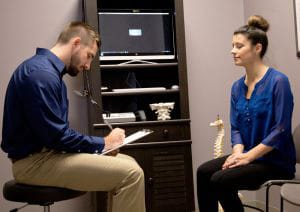 Chiropractor Traverse City MI Dr. Kyle Konas With Patient